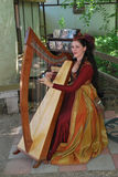 Harpist at Rennaissance Faire Royalty Free Stock Images