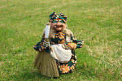 Harridan. The toy the old kind hag with a sweeper is on a green grass Royalty Free Stock Photos