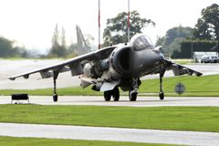 Harrier Jump Jet. An RAF Harrier taxis to the runway at RNAS Yeovilton royalty free stock photos