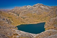 Harris lake from Conical hill on Routeburn track in New Zealand. South island of NZ, mountain adventure, great walks, trekking and camping royalty free stock photography
