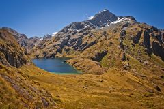 Harris Lake from the valley of Routeburn track in New Zealand. Lonely planet guide, natural beauty of New Zealand, South island of NZ, mountain adventure stock photography