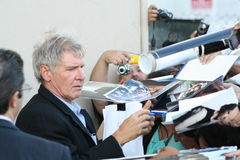 Harrison Ford. Harrision chatting and signing autographs stock photography