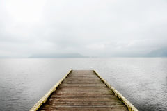 Harrison Lake, British Columbia, Canada. A dock located on Harrison Lake taken during a foggy winter morning gives a peaceful feel to the area Stock Image