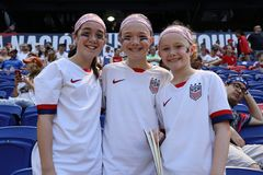 Soccer fans support U.S. Women`s National Soccer Team at Red Bull Stadium during friendly game against Mexico. HARRISON, NJ - MAY 26, 2019: Soccer fans support U royalty free stock photo