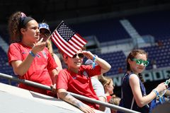 Soccer fans support U.S. Women`s National Soccer Team at Red Bull Stadium during friendly game against Mexico. HARRISON, NJ - MAY 26, 2019: Soccer fans support U royalty free stock image