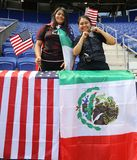 Soccer fans support U.S. Women`s National Soccer Team at Red Bull Stadium during friendly game against Mexico. HARRISON, NJ - MAY 26, 2019: Soccer fans support U stock image