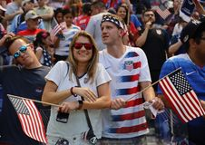 Soccer fans support U.S. Women`s National Soccer Team at Red Bull Stadium during friendly game against Mexico. HARRISON, NJ - MAY 26, 2019: Soccer fans support U royalty free stock photography
