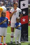 U.S. Women`s National Soccer Team captain Alex Morgan #13 during National Anthem before friendly game against Mexico. HARRISON, NJ - MAY 26, 2019: U.S. Women`s stock photo