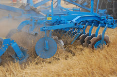 Harrowing by discs. Harrowing field by disc harrow at the autumn Royalty Free Stock Images