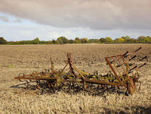 Harrows in a plowed field Stock Image