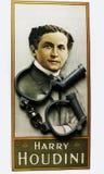 Harry Houdini-Porträt auf Plakat mit den Handschellen stockfoto