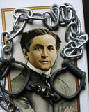 Harry Houdini portrait on poster with handcuffs & chains. High security handcuffs as used by the police in UK with chain and Harry Houdini portrait on poster Royalty Free Stock Photos