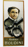 Harry Houdini portrait on poster with handcuffs. High security handcuffs as used by the police in UK with chain and Harry Houdini portrait on poster Stock Photo