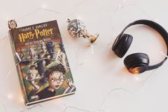 Harry Potter Book and Black Headphones With Trinket Stock Photography