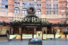 Harry Potter and the Cursed Child. LONDON, UK - JULY 6, 2016: People walk by Palace Theatre in London, UK. The theatre promotes Harry Potter and the Cursed Child Royalty Free Stock Images
