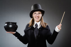 The harry potter girl with magic stick and pot Royalty Free Stock Image