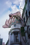 Harry Potter Gringotts Dragon. Fierce dragon Sits on top of Gringotts Bank in Universal Studios Orlando Wizarding World of Harry Potter Attraction royalty free stock photos