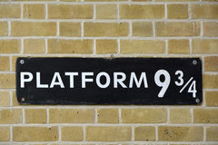 Harry Potter Platform nine and three quarters. Sign on wall at Kings Cross station visited by fans of Harry Potter and  Platform nine and three quarters Stock Photos