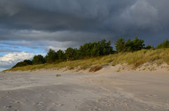 The harsh Baltic. Grey clouds above the beach of the Baltic sea Stock Images