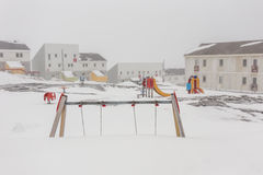 Harsh greenlandic childhood,playground covered in snow and ice. In Nuuk city, Greenland stock photography