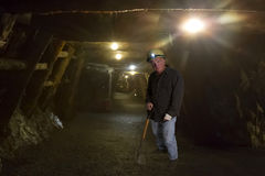 Harsh Life of a Coal Miner. Miner deep in the tunnels of an anthracite coal mine royalty free stock photo
