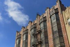 Harsh light, sun flare old art deco building, blue sky Royalty Free Stock Photos