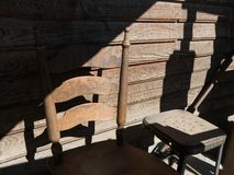 Deep shadows, wooden chair. Harsh lighting, deep shadows, details in wood royalty free stock images