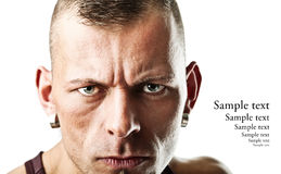 Harsh man. Closeup portrait of a harsh man; isolated on white stock images