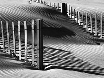 Lines in the Sand. Harsh midday sun creates dramatic shadows on the sand at Nags Head, North Carolina Stock Photo