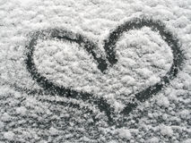 Hart. Made on snow covered window glass of a car royalty free stock photos