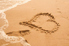 Hart on the beach. Beautiful Heart on the sand beach on the sea royalty free stock photography