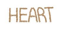 Hart in cheerios uit wordt gespeld die Stock Foto's