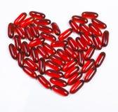 Hart dat van rode capsule wordt gemaakt Stock Afbeeldingen