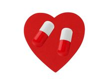 Hart en pillen op wit wordt geïsoleerd dat Royalty-vrije Stock Afbeelding