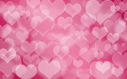 Hart gestalte gegeven vakantie vage bokeh achtergrond De achtergrond van de valentijnskaart royalty-vrije stock foto