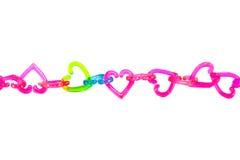 Het stuk speelgoed van het hart ketting. Stock Fotografie