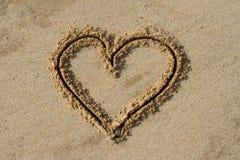 Hart in het zand Stock Foto's