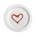 Hart from ketchup on white plate Royalty Free Stock Photography