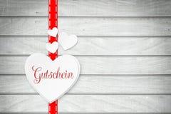 Hart met de woord` coupon ` in het Duits royalty-vrije stock afbeelding