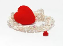 Hart met glas en parelparels Stock Afbeelding