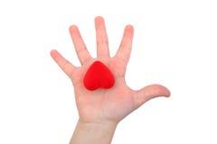 Hart op een child& x27; s hand Stock Afbeeldingen
