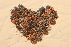 hart op het strand Stock Foto's