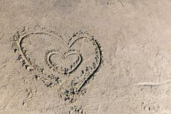 Hart in send. Two hart in sand on beach royalty free stock image