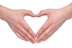 Hart van handen op een witte achtergrond De conceptie van de liefde royalty-vrije stock fotografie