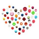 Hart van kleurrijke knopen stock afbeeldingen