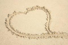 Hart in zand 2 Stock Afbeeldingen