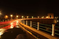 Hartbeespoort Dam Wall. Road over the Hartbeespoort Dam wall with car lights at night Royalty Free Stock Photo