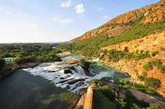 Hartbeespoort Dam and waterfall, Pretoria at sunset. Hartbeespoort Dam and waterfall in Pretoria at sunset Royalty Free Stock Photography