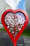 Harten aan een hart worden gespeld dat Royalty-vrije Stock Afbeeldingen
