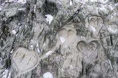 Harten in Steen worden gekrast die stock afbeeldingen
